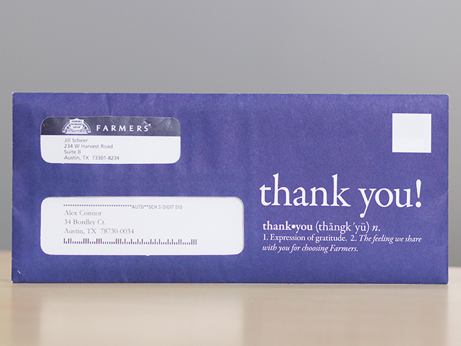 A custom printed direct mail outer envelope with address window