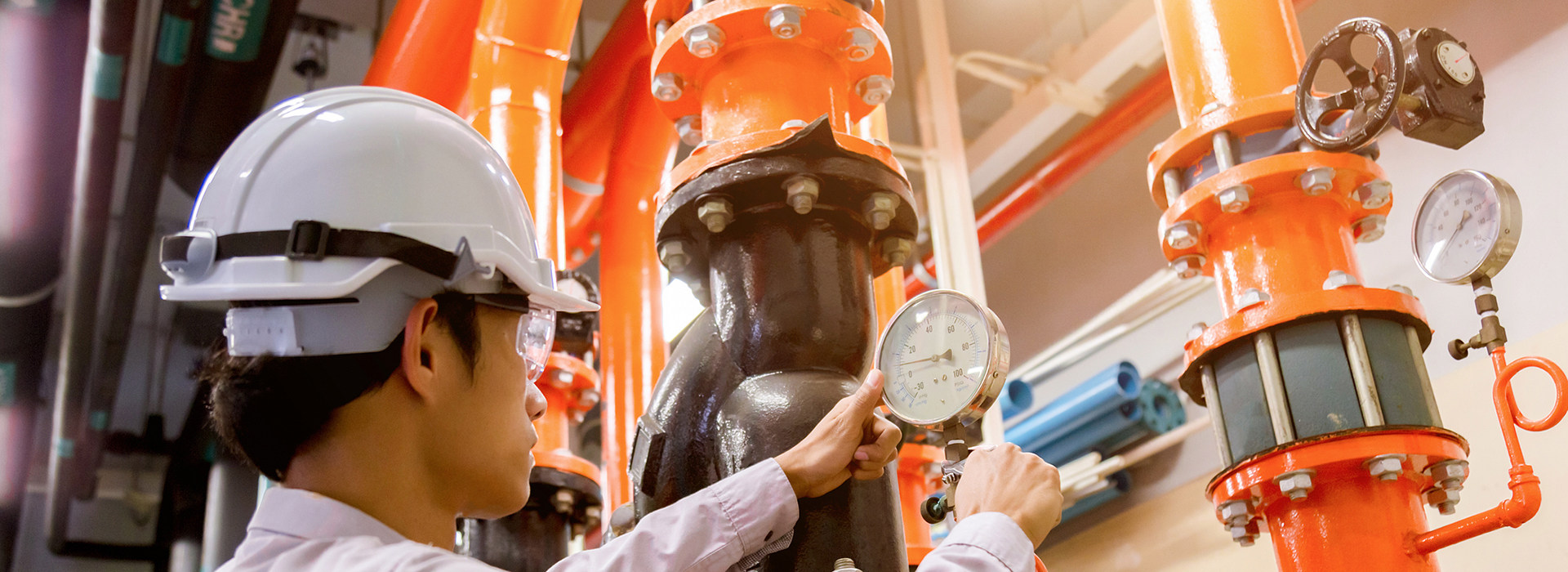 Man working with HVAC equipment in industrial setting