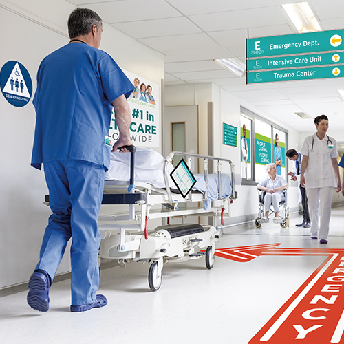 Architectural signage for healthcare including wayfinding signs floor graphics ADA compliant wall graphics and hanging signs
