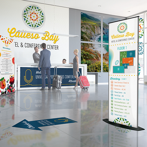 Architectural signage in hotel lobby including retractable banners wall graphics and window cling graphics