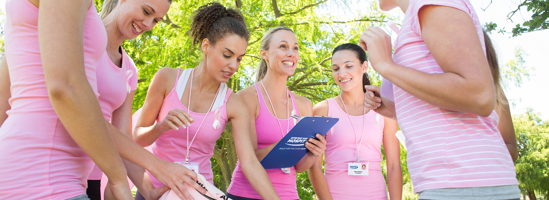 Women with custom printed lanyards and promotional marketing apparel participating in healthcare wellness event