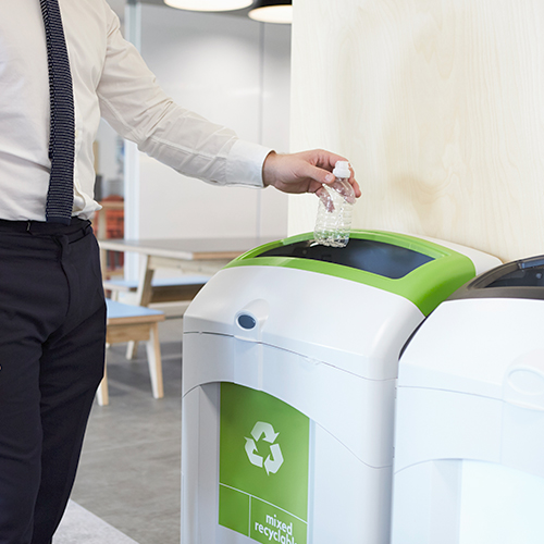 Man using a waste recycling container for recyclable packaging