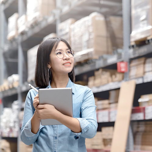 Woman in warehousing kitting and fulfillment distribution facility