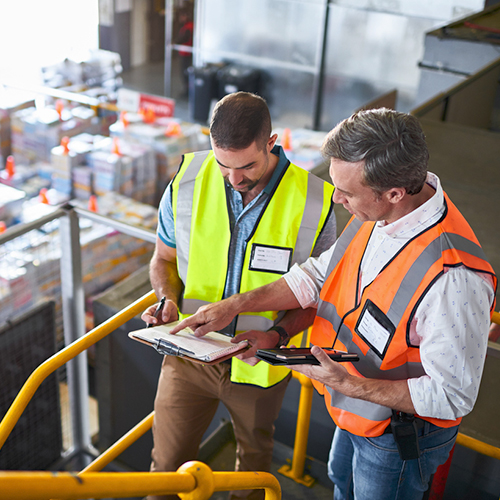 Men reviewing checklist in a warehousing kitting and fulfillment distribution facility
