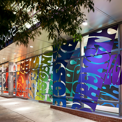 Colorful window cling graphics on exterior of retail storefront