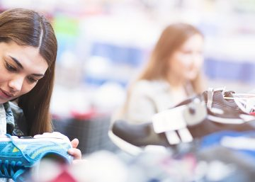 Woman making purchase decision in retail marketing setting