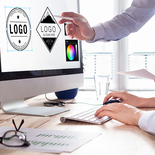 Creative design professionals reviewing designs and logos