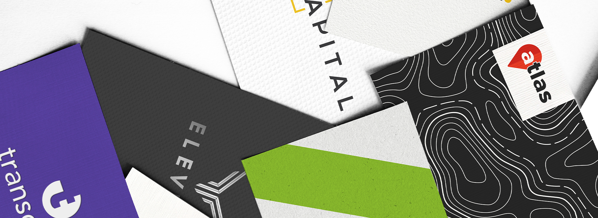 Closeup of brand collateral showing stipples embossing foil stamping and custom print finishes