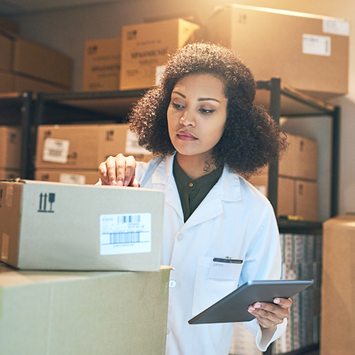 Warehouse kitting and fulfillment worker filling procurement order