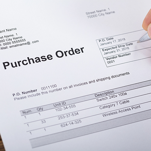 Procurement manager reviewing purchase order document