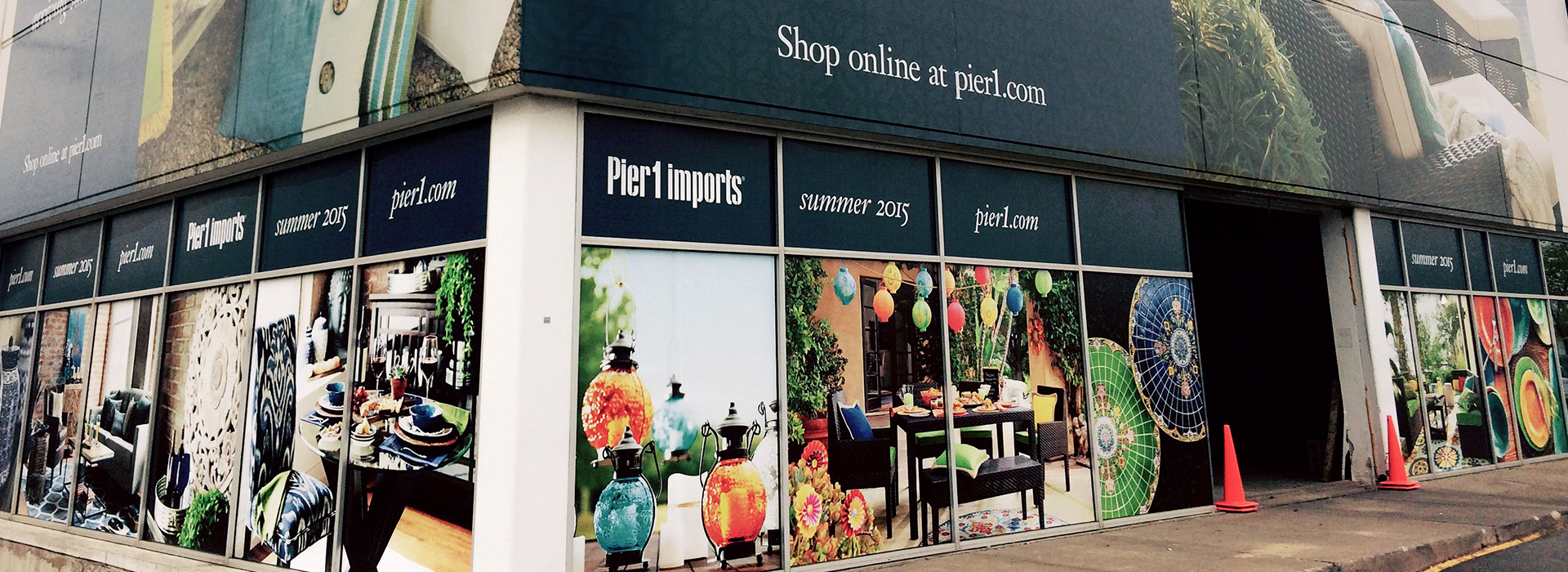 Window cling graphics and building wrap as examples of visual merchandising