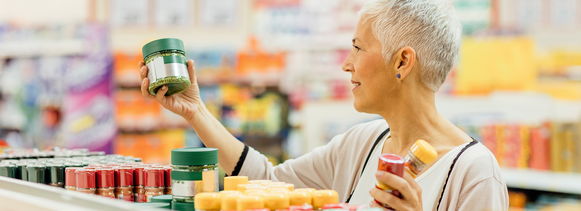 Consumer examining prime label on product in retail store