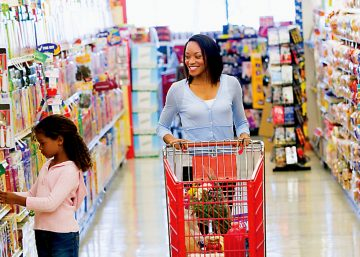 Family shopping in retail store with shelf talkers hang tags and retail packaging and labeling examples in view