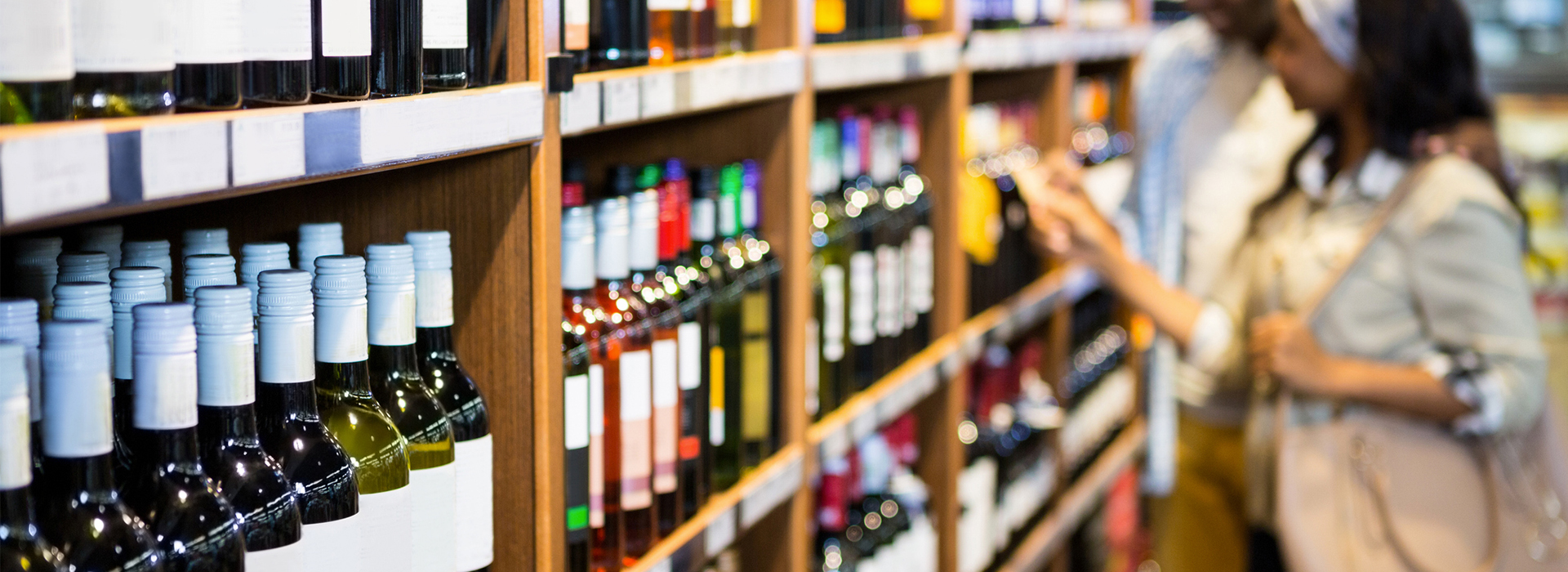 Wine and beverage packaging labels and shelf talker signage in retail setting
