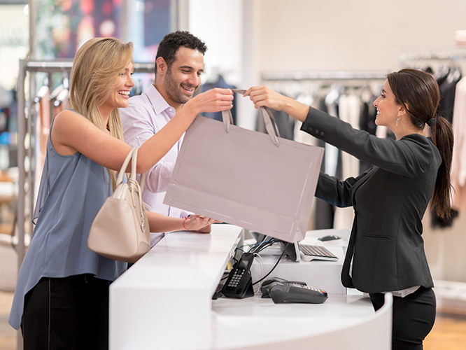 Customers making purchase in retail store environment
