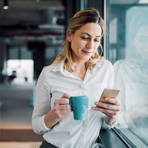 Woman using smartphone to make retail purchase