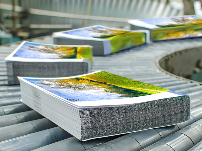 Commercial print brochures in print production facility
