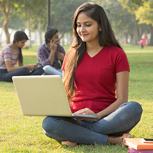 University student using a computer to study and complete coursework online