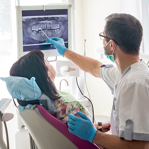 Dentist with patient as example of a healthcare industry provider who will benefit from print management services