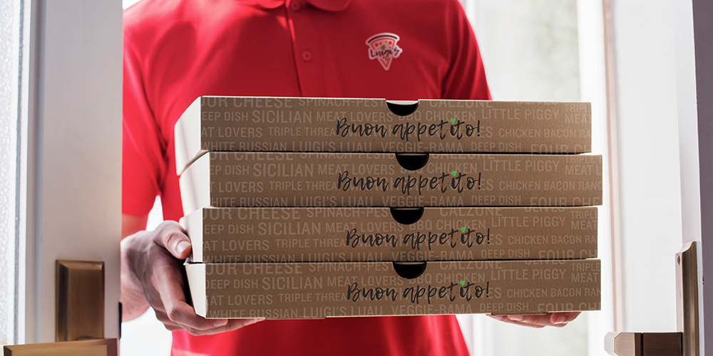 Pizza delivery driver wearing logo-branded apparel delivering pizzas in custom-printed pizza carton packaging