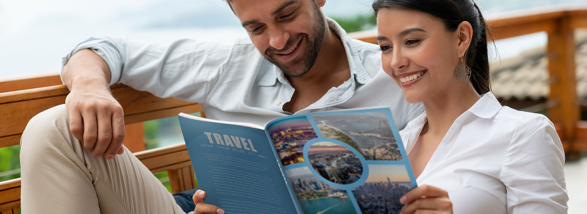 Couple reading printed brochure illustrating spot varnish and other enhanced print techniques