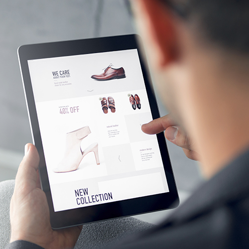 Man uses tablet mobile device to place an ecommerce order for home delivery