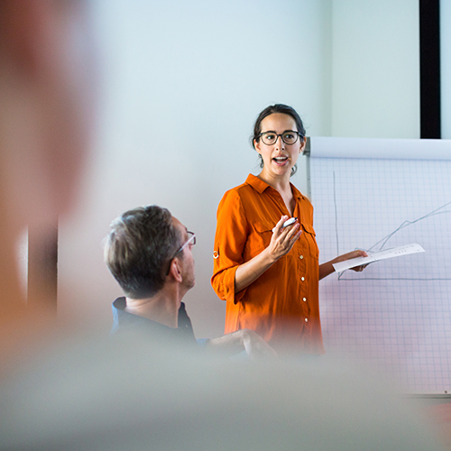 Woman speaking at an efficient business team meeting