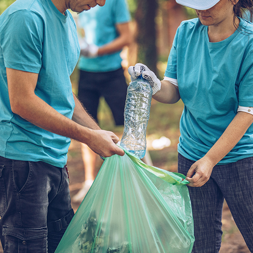 Group of millennials volunteers picking up trash