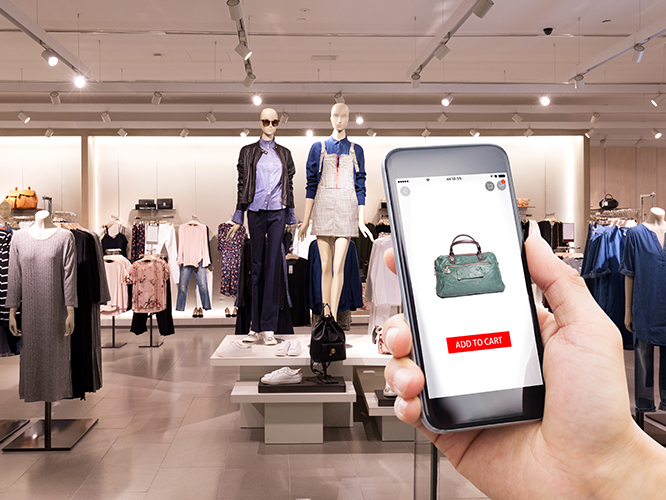Shopper using mobile phone app to learn about merchandise in product display
