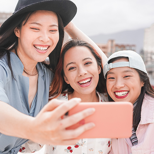 Group of female millennials taking a selfie