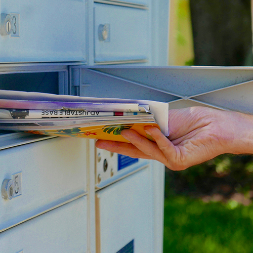Person removing printed mail from mailbox