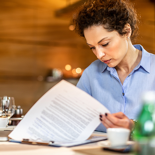 Restaurant worker reviewing new employee material