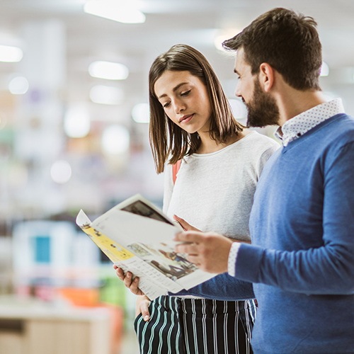 Man and woman reviewing printed brochure