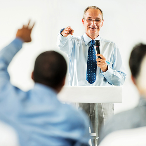 Man answering questions during a company meeting