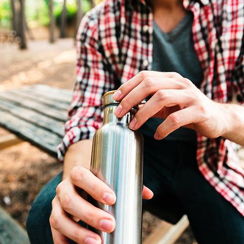 man-using-eco-friendly-water-bottle
