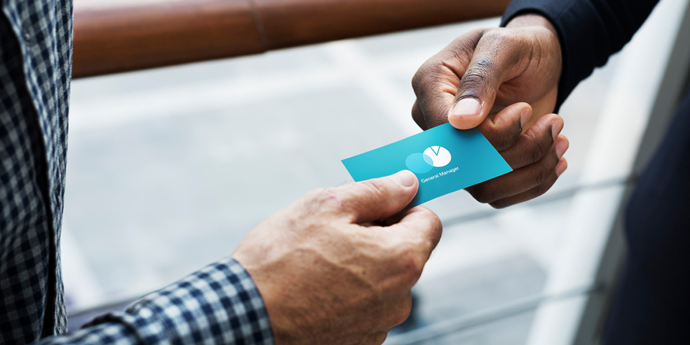 marketers exchanging business cards
